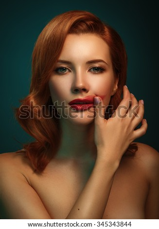 Beautiful woman. Portrait of young caucasian redhead female, red smeared lips. - stock photo
