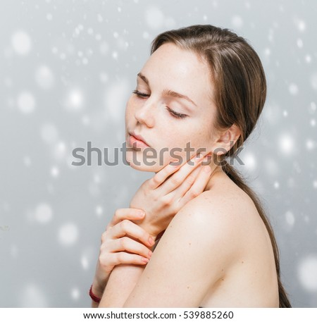 Beautiful woman portrait over snow winter background