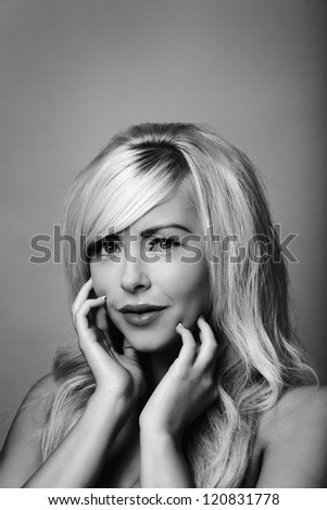 beautiful woman portrait posing in studio - stock photo
