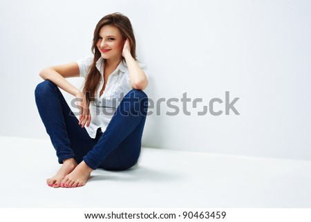 Beautiful woman portrait smiling and leaning against a wall