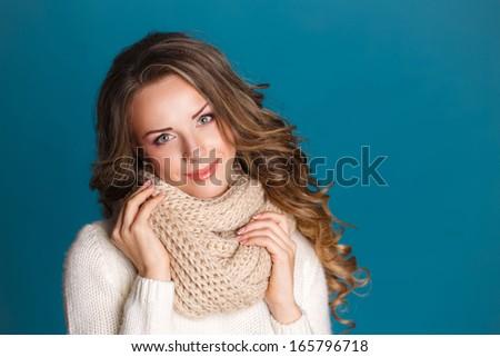 beautiful woman portrait wearing warm clothing. Studio portrait. - stock photo
