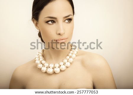 beautiful woman portrait with beauty makeup and stylish pearl necklace