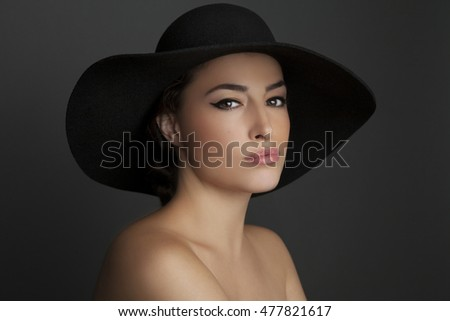 beautiful woman portrait with black hat and natural beauty makeup
