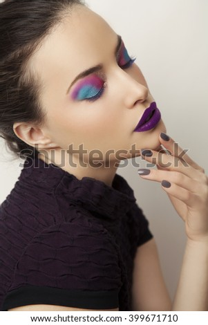 beautiful woman portrait with colorful makeup and eyes closed