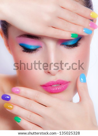 beautiful woman portrait with colorful makeup and nail polish, studio shot - stock photo