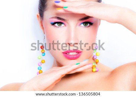 beautiful woman portrait with colorful makeup and nail polish, studio white