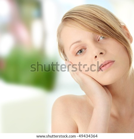 Beautiful woman portrait with hands on head - stock photo