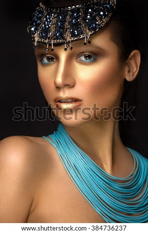 Beautiful woman portrait with jewelry in egyptian style
