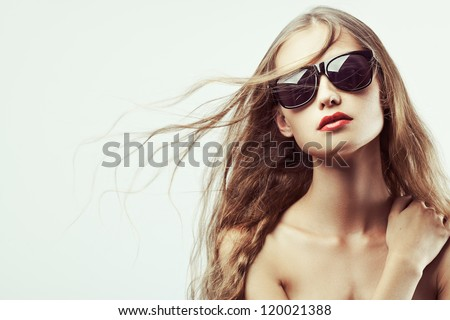 beautiful woman portrait with long hair wearing sunglasses