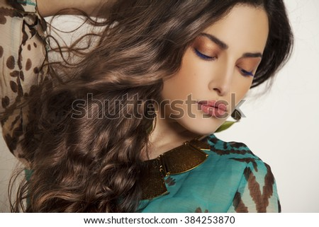 beautiful woman portrait with long healthy hair and nice natural makeup
