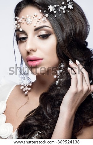 Beautiful woman portrait with nice makeup and white jewelry. Bride