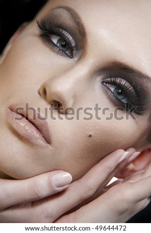 Beautiful woman portrait with professional make-up. Skin texture saved - stock photo