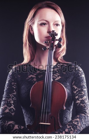 Beautiful woman portrait with violin Player violinist with music instrument - stock photo
