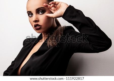 Beautiful woman pose in studio. Vogue style photo.