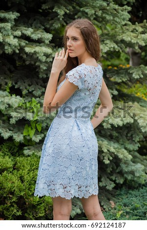 Beautiful woman posing in a dress outdoor