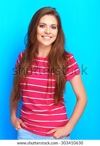 Beautiful woman posing in studio against blue background. Positive emotion. Smiling young woman. - stock photo