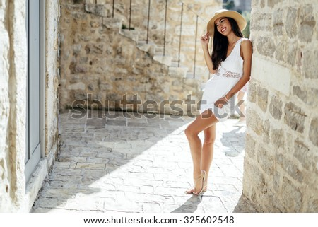 Beautiful woman posing in summer. Romantic shot