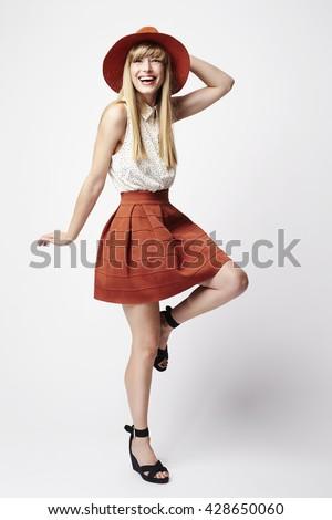 Beautiful woman posing in white studio - stock photo