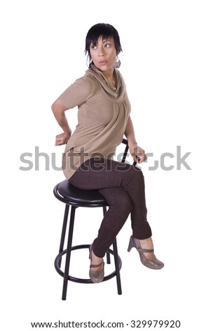 Beautiful Woman Posing on a Chair - Isolated White Background - stock photo