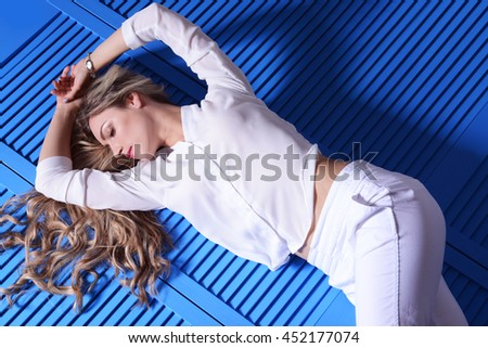 Beautiful woman posing on color background