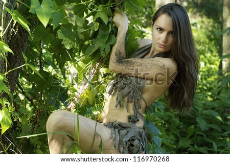 beautiful woman posing with a loincloth on the nature - stock photo