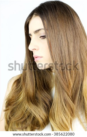 Beautiful woman posing with lot of straight gorgeous silky hair isolated