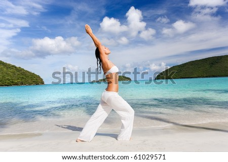 beautiful woman practicing yoga on beach - stock photo