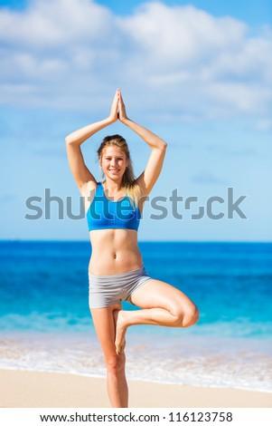 beautiful woman practicing yoga on the beach in Hawai - stock photo