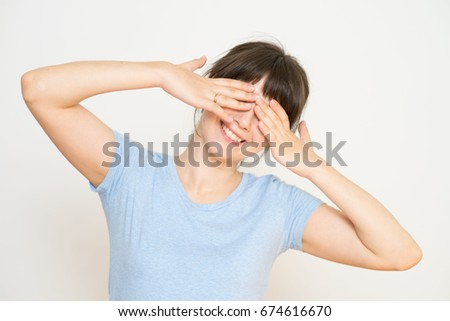 Beautiful woman pretending to sleep resting her head on her hands with her eyes closed isolated on white