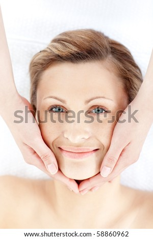 Beautiful woman receiving a facial massage in a health spa