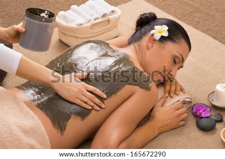 Beautiful Woman Receiving A Mud Therapy - stock photo