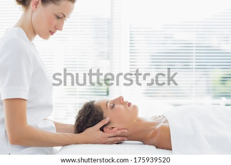 Beautiful woman receiving massage from physical therapist - stock photo