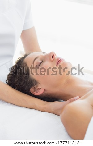 Beautiful woman receiving neck massage in health spa - stock photo