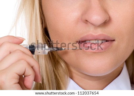 Beautiful woman recieving a injection in her lip.Isolated on white - stock photo