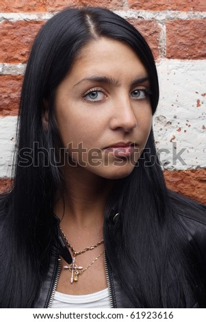 beautiful woman red bricks wall background. More images of this models you can find in my portfolio - stock photo