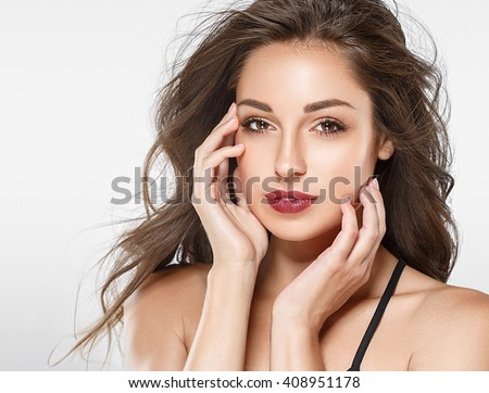 Beautiful woman red lips fly hair portrait healthy skin - stock photo