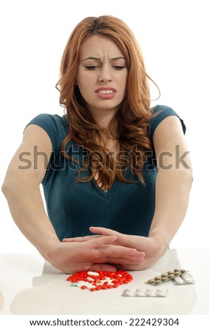 Beautiful woman refuse to take pills. Patient saying no to medical treatment - stock photo