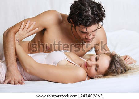 Beautiful woman refusing intimacy with her man in bed . Couple problems concept