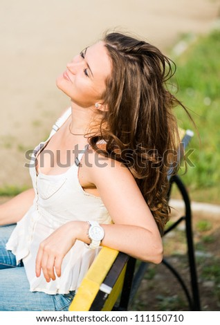 beautiful woman relax on the bench in park
