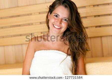 Beautiful woman relaxing a sauna - stock photo