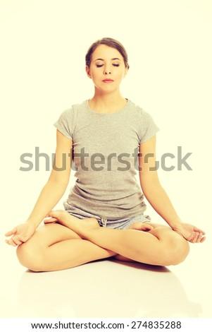 Beautiful woman relaxing by yoga - stock photo