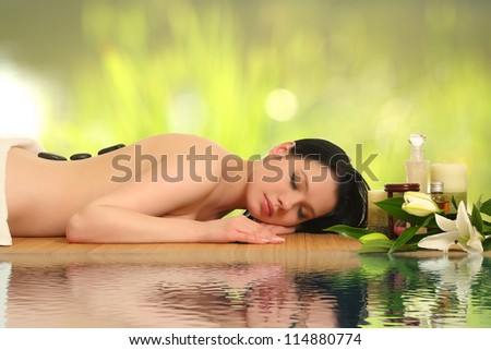 beautiful woman relaxing in spa - stock photo