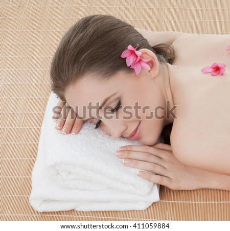 beautiful woman relaxing in spa. - stock photo