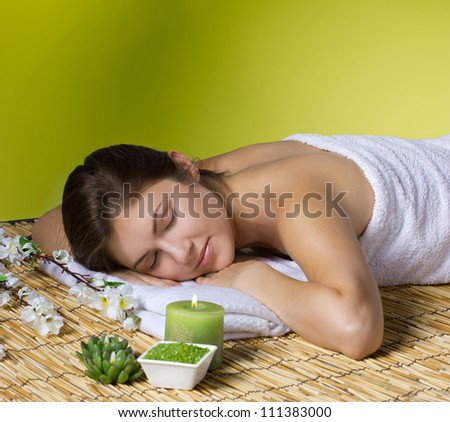 beautiful woman relaxing in spa salon