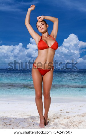 Beautiful woman relaxing on beach at Maldives