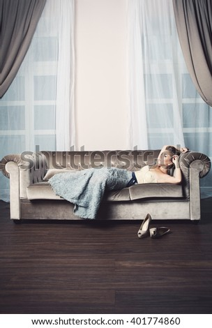 Beautiful Woman Relaxing on Luxury Interior - stock photo