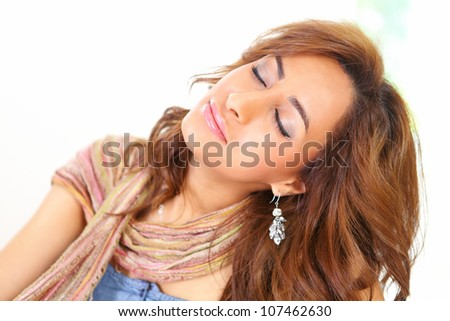 Beautiful woman relaxing with eyes closed a horizontal portrait