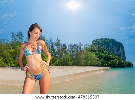 Beautiful woman relexing on the beach. Poda island. Thailand