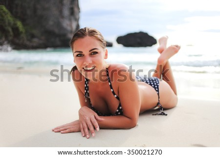 Beautiful woman rest on the beach - stock photo