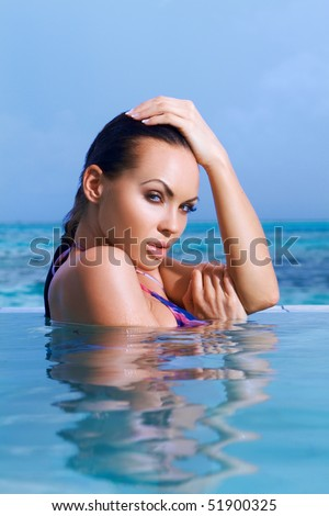 Beautiful woman resting in pool at Maldives